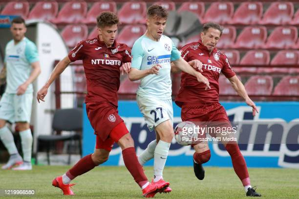 Darius Olaru of FCSB battles with Cristian Itu and Ciprian Deac of CFR Cluj during the match between CFR Cluj and FCSB in the play-off of Romanias...