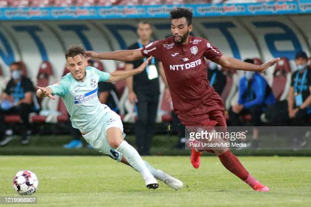 Darius Olaru of FCSB competes with Billel Omrani of CFR Cluj during the Liga I play-off between CFR Cluj and FCSB on June 14, 2020 in Cluj-Napoca,...