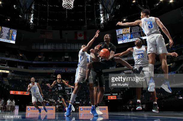 Darius Perry of the Central Florida Knights drives to the basket against Landers Nolley II of the Memphis Tigers during a game on February 3, 2021 at...