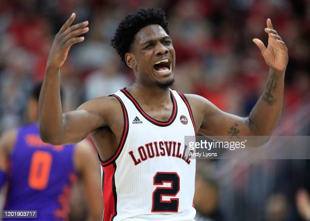 Darius Perry of the Louisville Cardinals celebrates after making a three point shot against the Clemson Tigers at KFC YUM! Center on January 25, 2020...