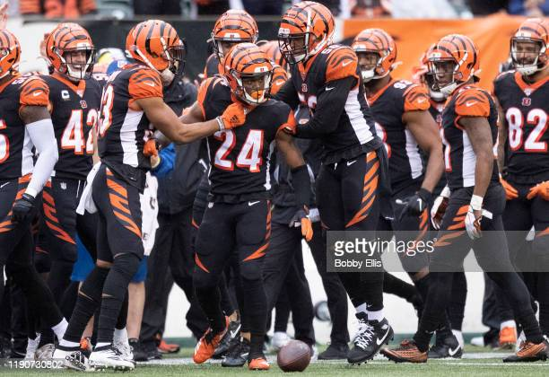 Darius Phillips of the Cincinnati Bengals and the Cincinnati Bengals defense celebrate after Phillips made an interception in the third quarter of...