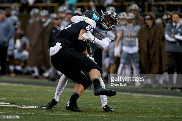 Darius Phillips of the Western Michigan Broncos tackles Mason Schreck of the Buffalo Bulls in the second quarter at Waldo Stadium on November 19,...