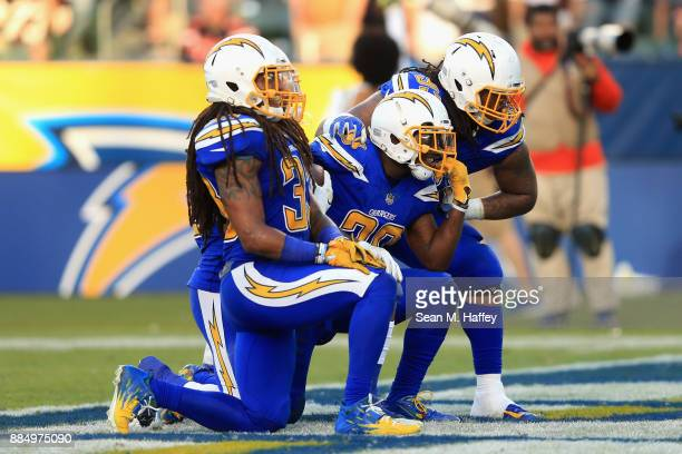 Darius Philon Tre Boston and Desmond King of the Los Angeles Chargers react after a fumble recovery during the second half of a game against the...