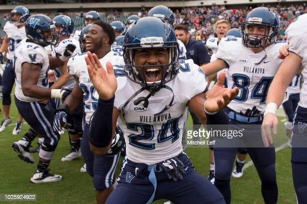 Darius Pickett, Amin Black, and Robert Brady of the Villanova Wildcats celebrate after the game against the Temple Owls at Lincoln Financial Field on...