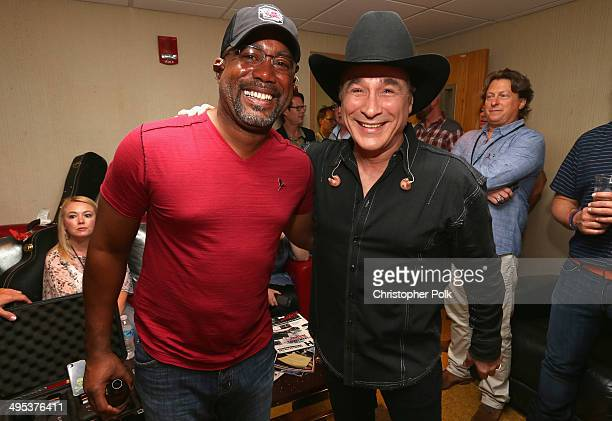 Darius Rucker and Clint Black pose backstage during the Fifth annual Darius and Friends concert at Wildhorse Saloon on June 2 2014 in Nashville...