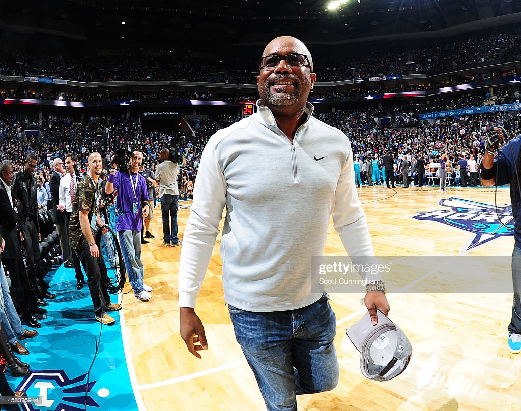 Darius Rucker heads off the court after singing the national anthem before the game between the Charlotte Hornets and the Milwaukee Bucks on October 29, 2014 at Time Warner Cable Arena in Charlotte, North Carolina.