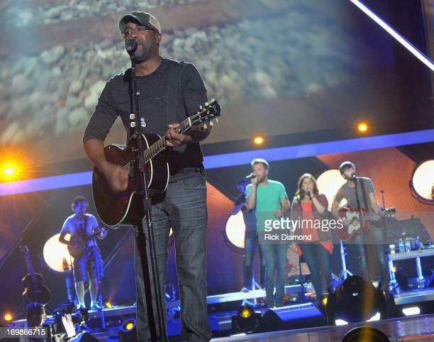 Darius Rucker performs with Charles Kelley Hillary Scott and Dave Haywood of Lady Antebellum during the 2013 CMT Music Awards Rehearsals Day 1 at...