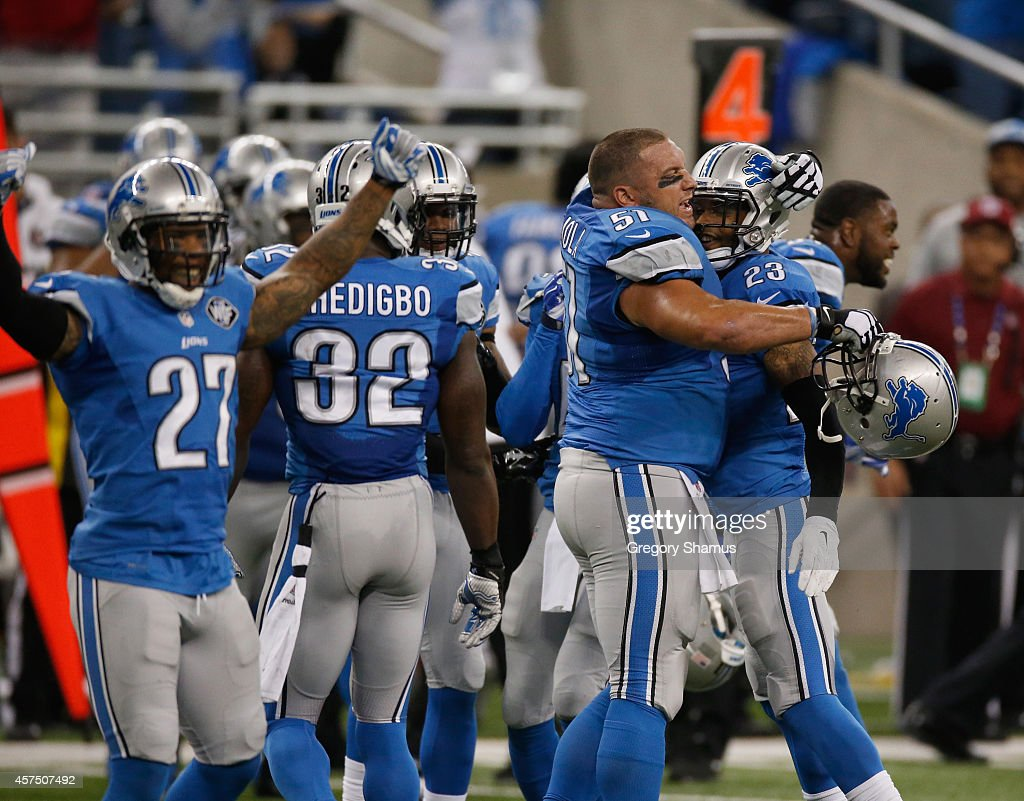 Darius Slay #23 and Dominic Raiola #51 of the Detroit Lions celebrate with teammates after a 24-23 win over the New Orleans Saints at Ford Field on October 19, 2014 in Detroit, Michigan.