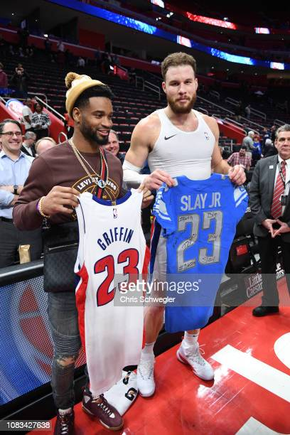 Darius Slay Jr of the Detriot Lions and Blake Griffin of the Detroit Pistons exchange jerseys after the game on January 16 2019 at Little Caesars...