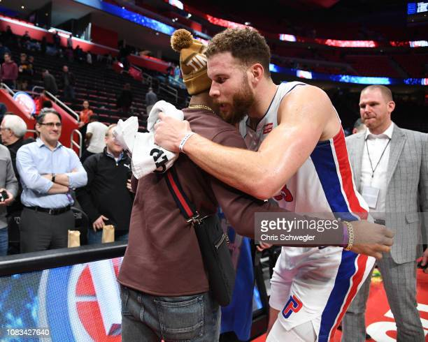 Darius Slay Jr of the Detroit Lions hugs Blake Griffin of the Detroit Pistons after the game against the Orlando Magic on January 16 2019 at Little...