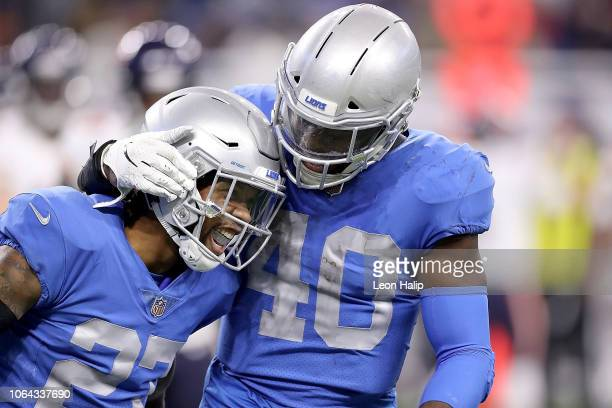 Darius Slay of the Detroit Lions and Jarrad Davis of the Detroit Lions celebrate a sack of quarterback Chase Daniel of the Chicago Bears at Ford...