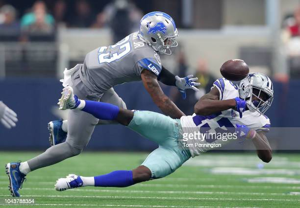 Darius Slay of the Detroit Lions breaks up a pass intended for Michael Gallup of the Dallas Cowboys in the fourth quarter of a game at AT&T Stadium...