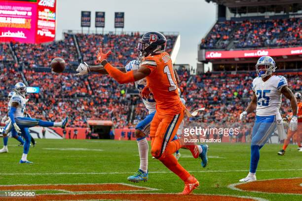 Darius Slay of the Detroit Lions breaks up a pass intended for Courtland Sutton of the Denver Broncos in the end zone during a game at Empower Field...