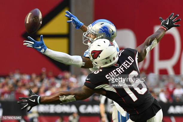 Darius Slay of the Detroit Lions catches the ball intended for Trent Sherfield of the Arizona Cardinals then runs the ball 67 yards for a touchdown...