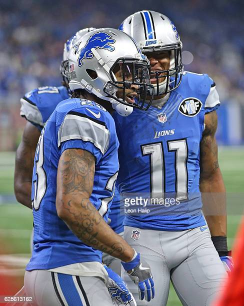 Darius Slay of the Detroit Lions celebrates after making a late fourth quarter interception with teammate Marvin Jones during the annual Thanksgiving...