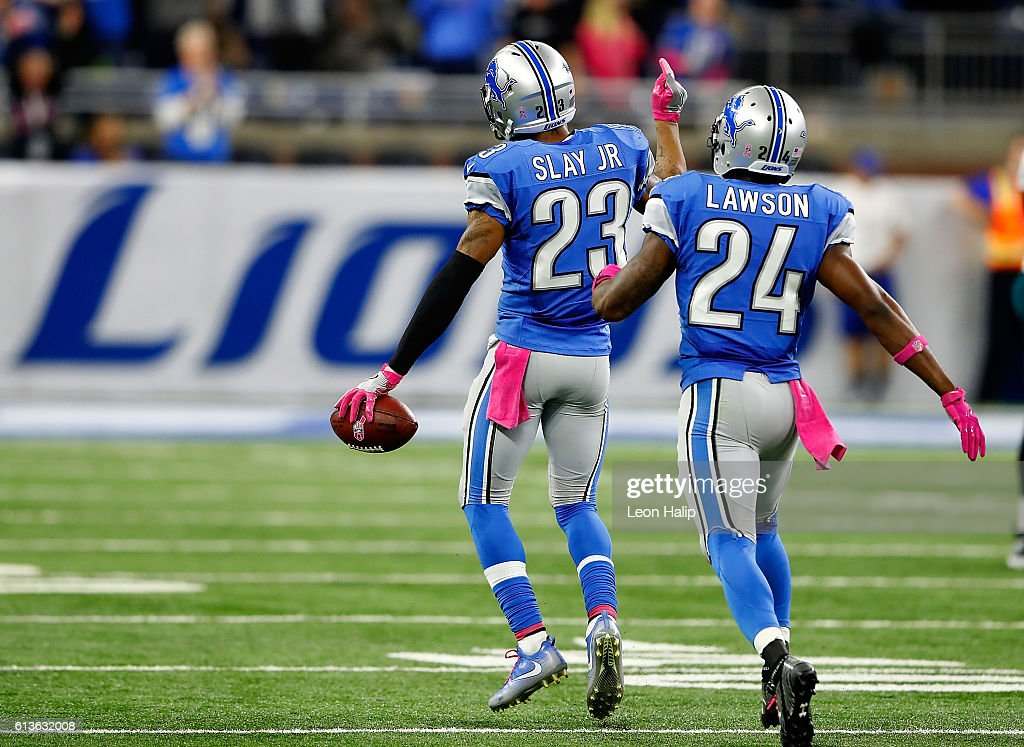 Darius Slay #23 of the Detroit Lions celebrates his interception with Nevin Lawson #24 against the Philadelphia Eagles in the final minutes of the game at Ford Field on October 9, 2016 in Detroit, Michigan. The Lions defeated the Eagles 24-23.