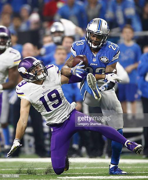 Darius Slay of the Detroit Lions intercepts a pass in front of Adam Thielen of the Minnesota Vikings with 30 seconds left in the fourth quarter at...
