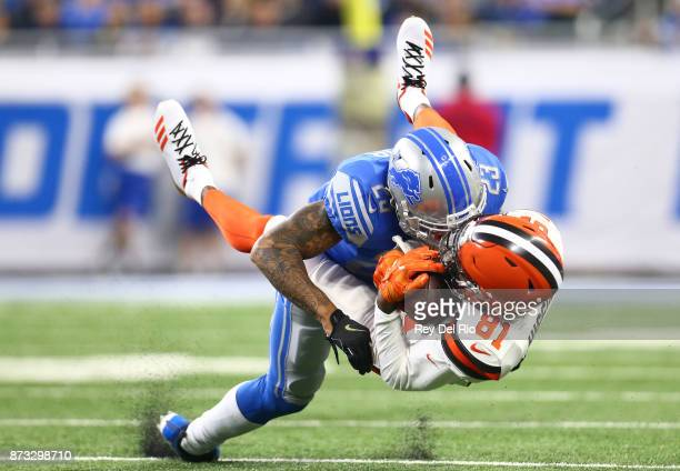 Darius Slay of the Detroit Lions makes a tackle against Rashard Higgins of the Cleveland Browns during the first half at Ford Field on November 12,...