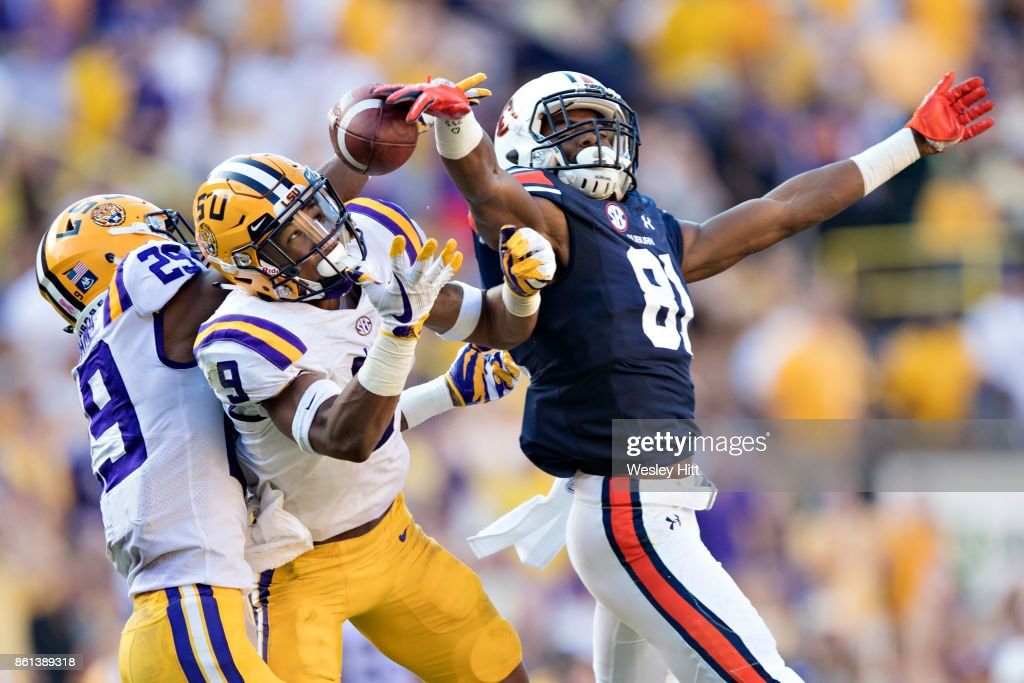 Darius Slayton #81 of the Auburn Tigers breaks up a pass thrown to him so that it is not intercepted by Grant Delphit #9 or Andraez Williams #29 of the LSU Tigers at Tiger Stadium on October 14, 2017 in Baton Rouge, Louisiana. The LSU defeated the Auburn 27-23.
