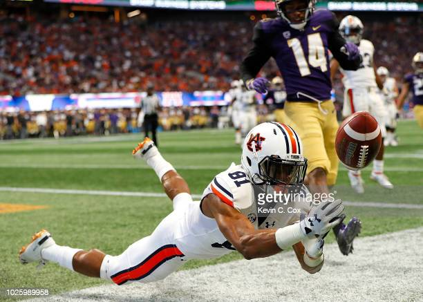 Darius Slayton of the Auburn Tigers fails to pull in this touchdown reception against the Washington Huskies at MercedesBenz Stadium on September 1...