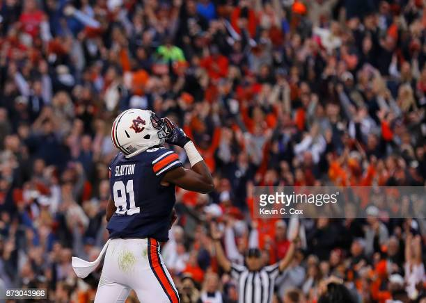Darius Slayton of the Auburn Tigers reacts after pulling in a touchdown reception against the Georgia Bulldogs at Jordan Hare Stadium on November 11...