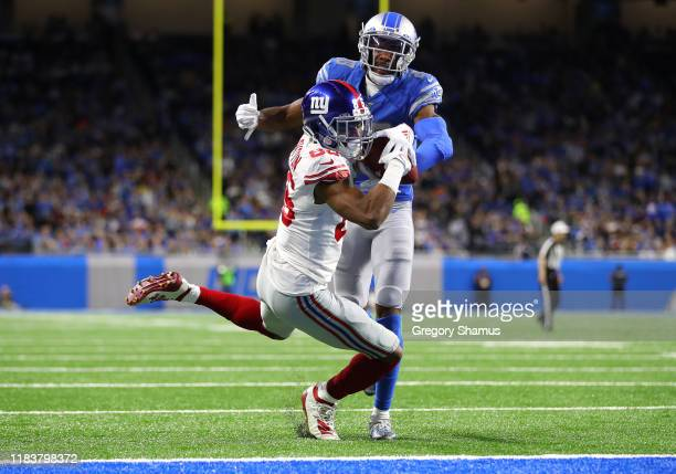 Darius Slayton of the New York Giants catches a second quarter touchdown in front of Rashaan Melvin of the Detroit Lions at Ford Field on October 27...