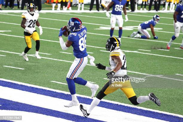 Darius Slayton of the New York Giants catches a seven yard touchdown pass against Steven Nelson of the Pittsburgh Steelers during the fourth quarter...