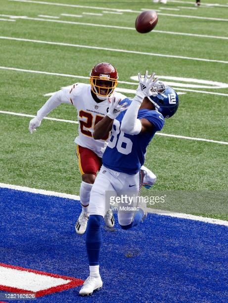 Darius Slayton of the New York Giants hauls in a touchdown during the first quarter against Fabian Moreau of the Washington Football Team at MetLife...