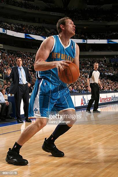 Darius Songaila of the New Orleans Hornets drives the ball to the basket during the game against the Dallas Mavericks on December 14 2009 at American...