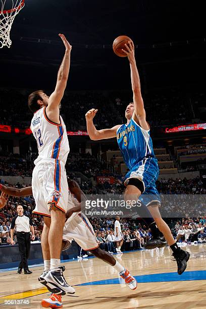Darius Songaila of the New Orleans Hornets goes to the basket against Nenad Krstic of the Oklahoma City Thunder on January 6 2010 at the Ford Center...
