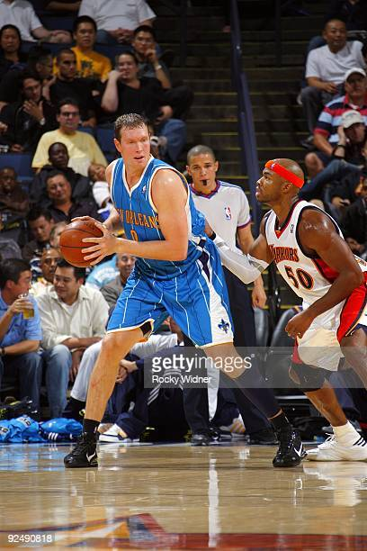 Darius Songaila of the New Orleans Hornets looks to make a move against Corey Maggette of the Golden State Warriors during a preseason game at Oracle...