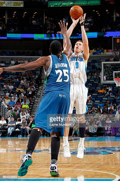 Darius Songaila of the New Orleans Hornets shoots over Al Jefferson of the Minnesota Timberwolves on April 11 2010 at the New Orleans Arena in New...