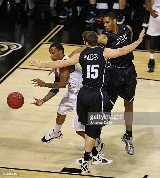 Darius Theus of the VCU Rams passes under pressure from Jake Kretzer and Zeke Marshall of the Akron Zips during the second round of the 2013 NCAA...