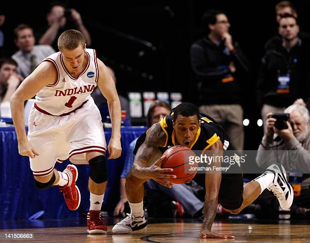 Darius Theus of the Virginia Commonwealth Rams goes after the ball next to Jordan Hulls of the Indiana Hoosiers in the second half during the third...