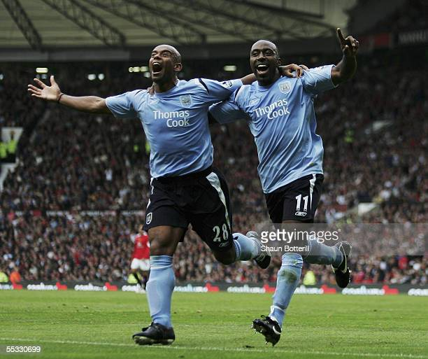 Darius Vassell and Trevor Sinclair of Manchester City celebrate the City goal during the Barclays Premiership match between Manchester United v...