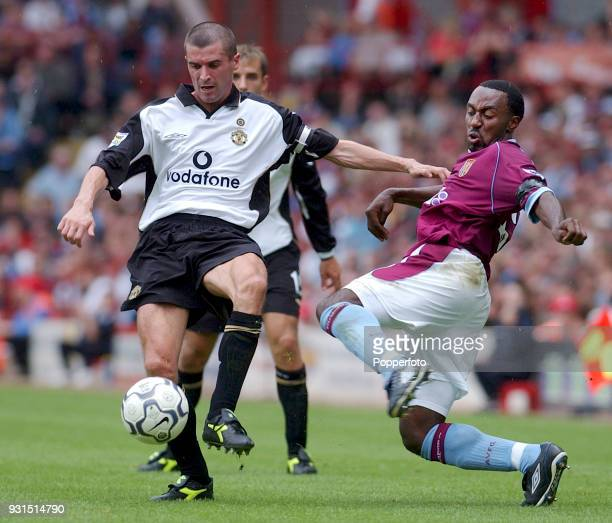 Darius Vassell of Aston Villa challenges Roy Keane of Manchester United during the FA Barclaycard Premiership match between Aston Villa and...