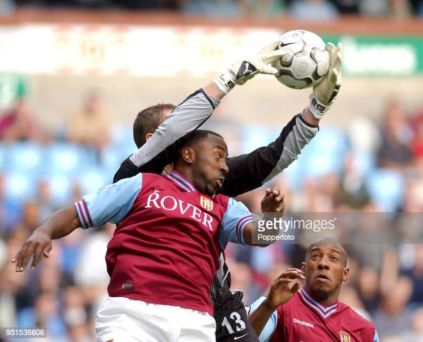 Darius Vassell of Aston Villa clashes with Leeds United goalkeeper Paul Robinson whilst Dion Dublin looks on during the FA Barclaycard Premiership...