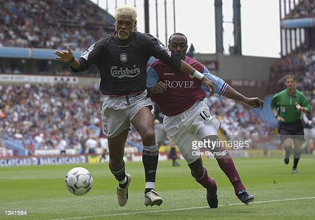 Darius Vassell of Aston Villa tackles Abel Xavier of Liverpool during the FA Barclaycard Premiership match between Aston Villa and Liverpool at Villa...