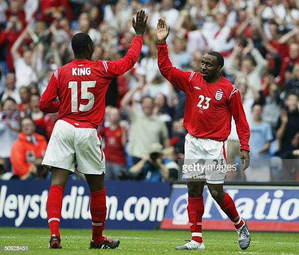 Darius Vassell of England celebrates scoring with Ledley King during the FA Summer Tournament match between England and Iceland at the City of...