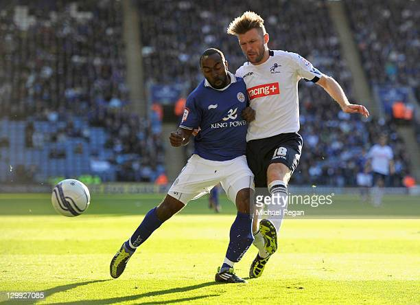 Darius Vassell of Leicester in action with Darren Ward of Millwall during the npower Championship match between Leicester City and Millwall at the...