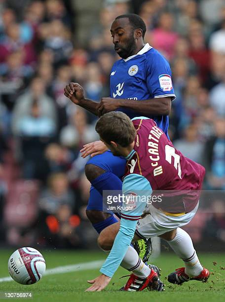 Darius Vassell of Leicester is challenged by George McCartney of West Ham during the npower Championship match between West Ham United and Leicester...