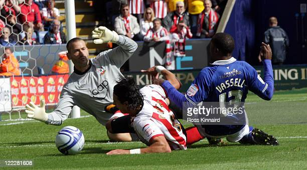 Darius Vassell of Leicester is Challenged by Jose Fonte of Southampton during the npower Championship match between Leicester City v Southampton at...