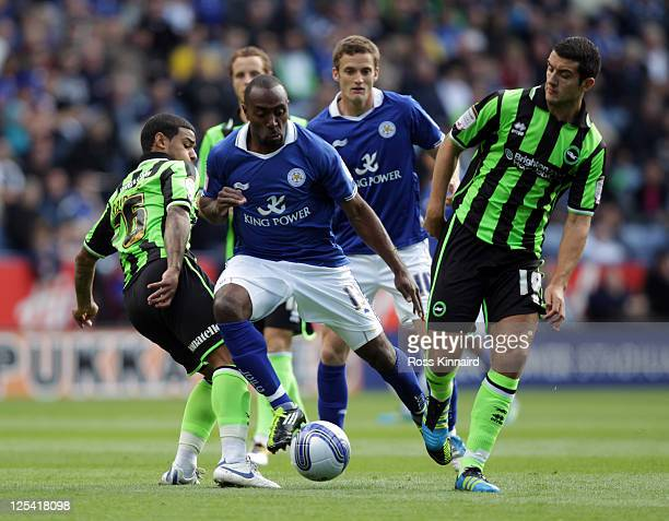 Darius Vassell of Leicester is challenged by Liam Bridcutt of Brighton during the npower Championship match between Leicester City and Brighton Hove...