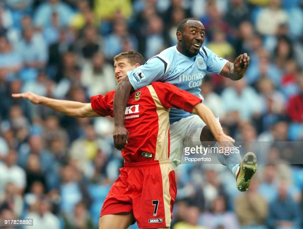 Darius Vassell of Manchester City clashes with Gregory Vignal of Portsmouth during the Barclays Premiership match between Manchester City and...