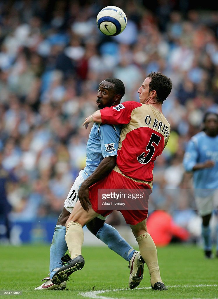 Darius Vassell of Manchester City is stopped by Andy O'Brien of Portsmouth during the Barclays Premiership match between Manchester City and Portsmouth at the City of Manchester Stadium on August 27, 2005 in Manchester, England.