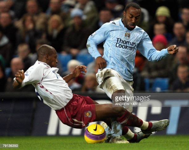 Darius Vassell of Manchester City is tackled by Louis Boa Morte of West Ham United during the Premier league football match at The City of Manchester...