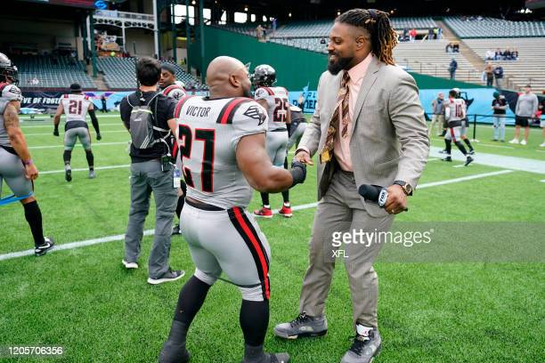 Darius Victor of the New York Guardians shakes hands with Cameron Jordan of the New Orleans Saints before the XFL game against the Dallas Renegades...
