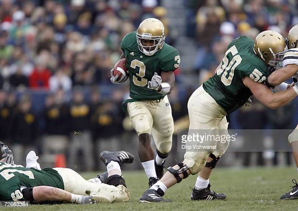 Darius Walker of the Notre Dame Fighting Irish carries the ball during the game against the Army Black Knights at Notre Dame Stadium on November 18...