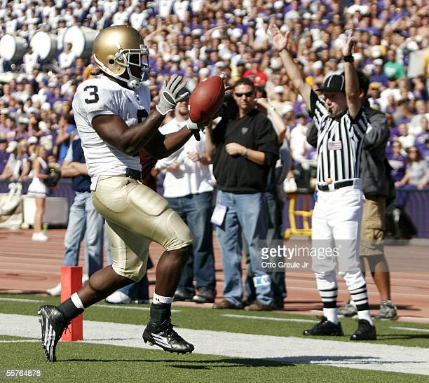 Darius Walker of the Notre Dame Fighting Irish rushes for a touchdown in the first half against the Washington Huskies on September 24, 2005 at Husky...