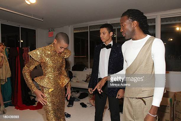 Darius Wobil preps models backstage at the St Wobil fashion show during MercedesBenz Fashion Week Spring 2014 at The Designer's Loft at Studio 450 on...